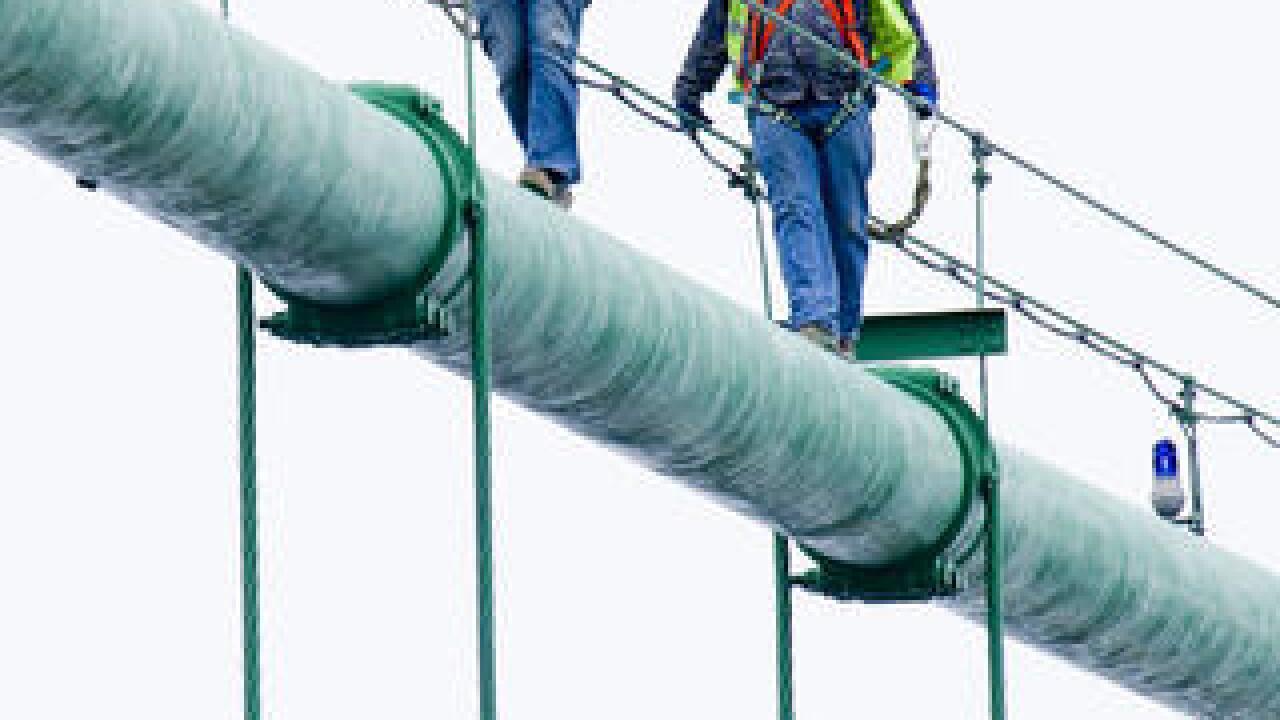 Workers preparing the Mackinac Bridge for winter