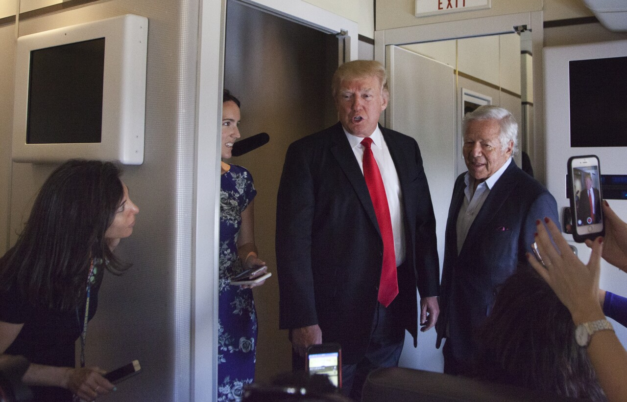 Donald Trump and Robert Kraft talk to press corp inside Air Force One at Palm Beach International Airport in 2017