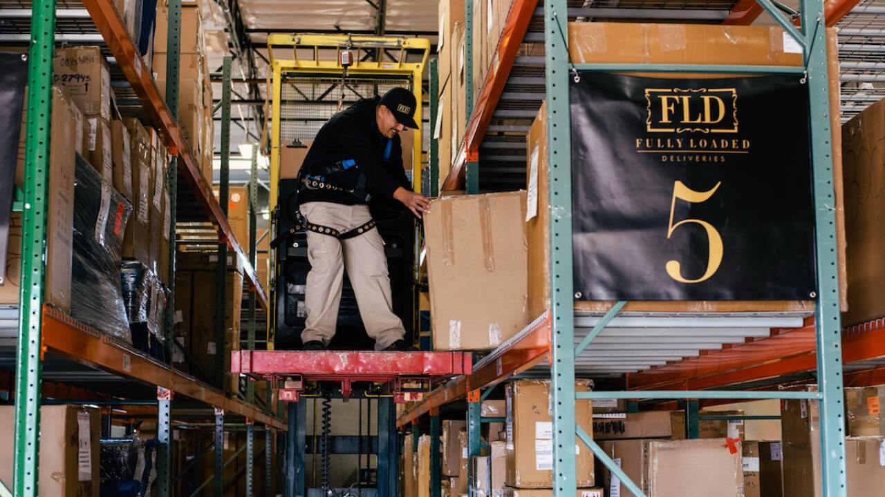 Credit: Crystal Clear Creative Studios  An employee works in the new warehouse for Fully Loaded Deliveries, which moved into its new north Phoenix headquarters last month.