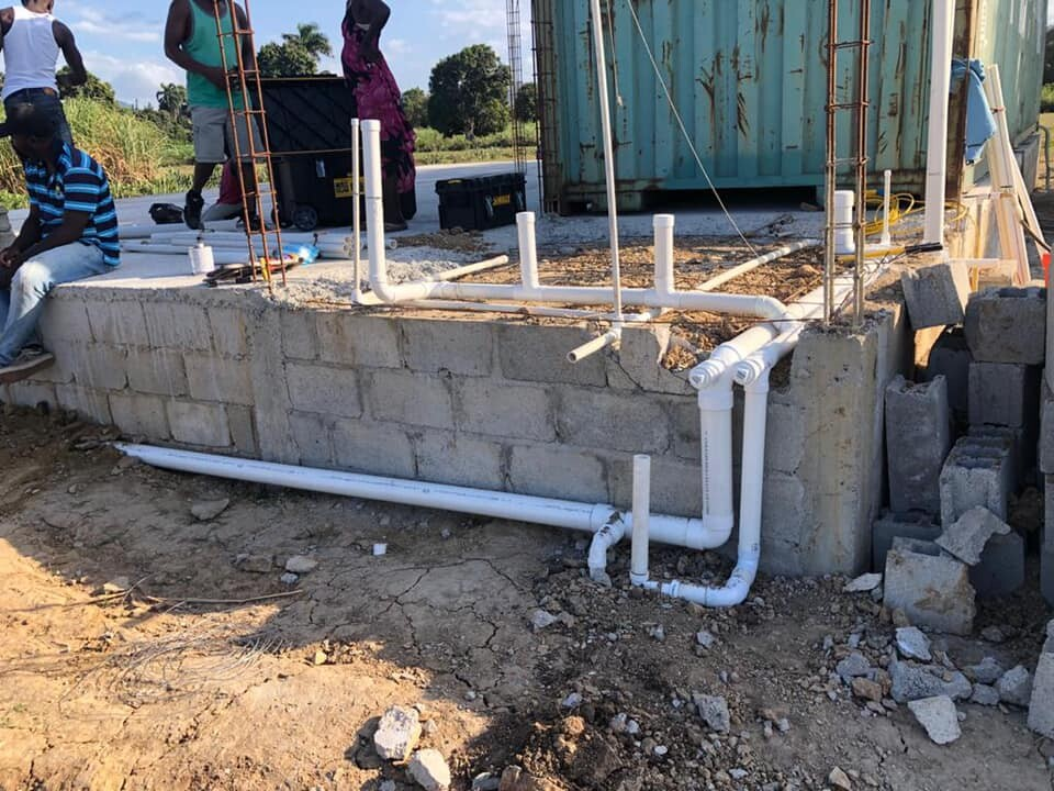 A concrete foundation waits in Haiti for the medical unit that will be placed on top of it. Many in the area will be receiving medical treatment in it for the first time in their lives.