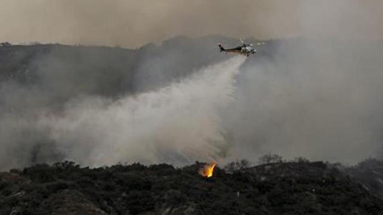 Improved weather helps responders battle wildfire in Southern California