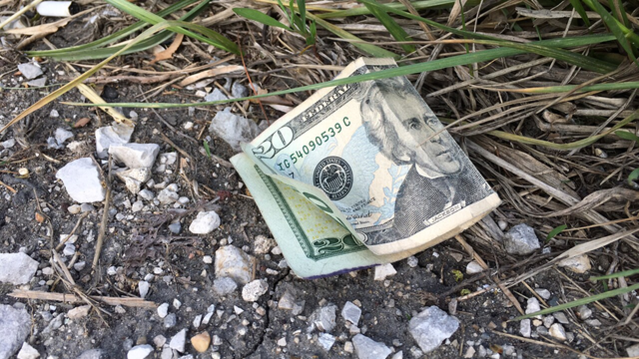 Cash falls on interstate from Brinks truck