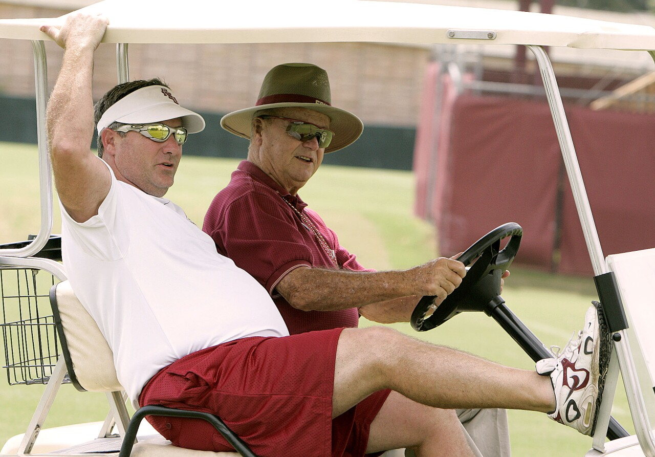 Florida State Seminoles head coach Bobby Bowden and offensive coordinator Jeff Bowden ride to practice in 2005