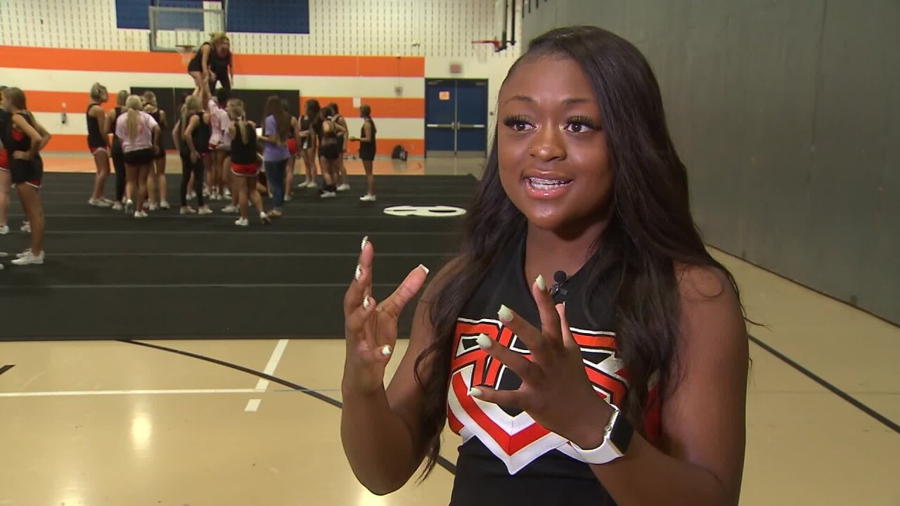 Texas cheerleader jumps off homecoming float to save choking boy