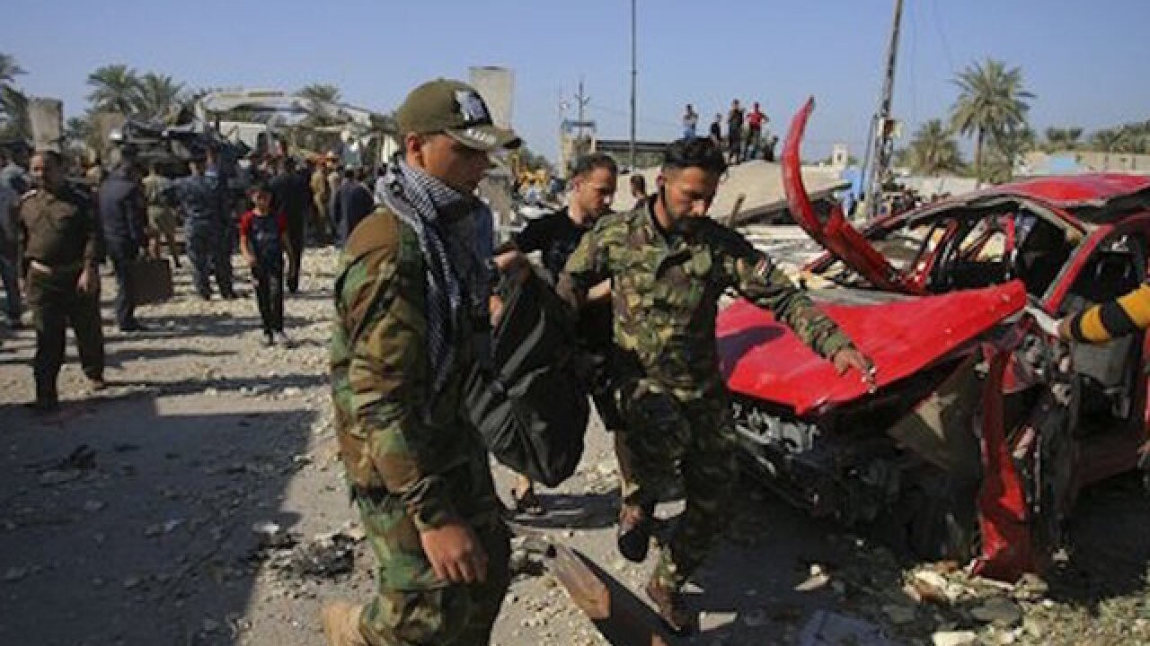 Suicide bomber kills more than a dozen in Iraq