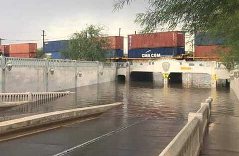 Lake Elimira forms during heavy monsoon storms in downtown Tucson