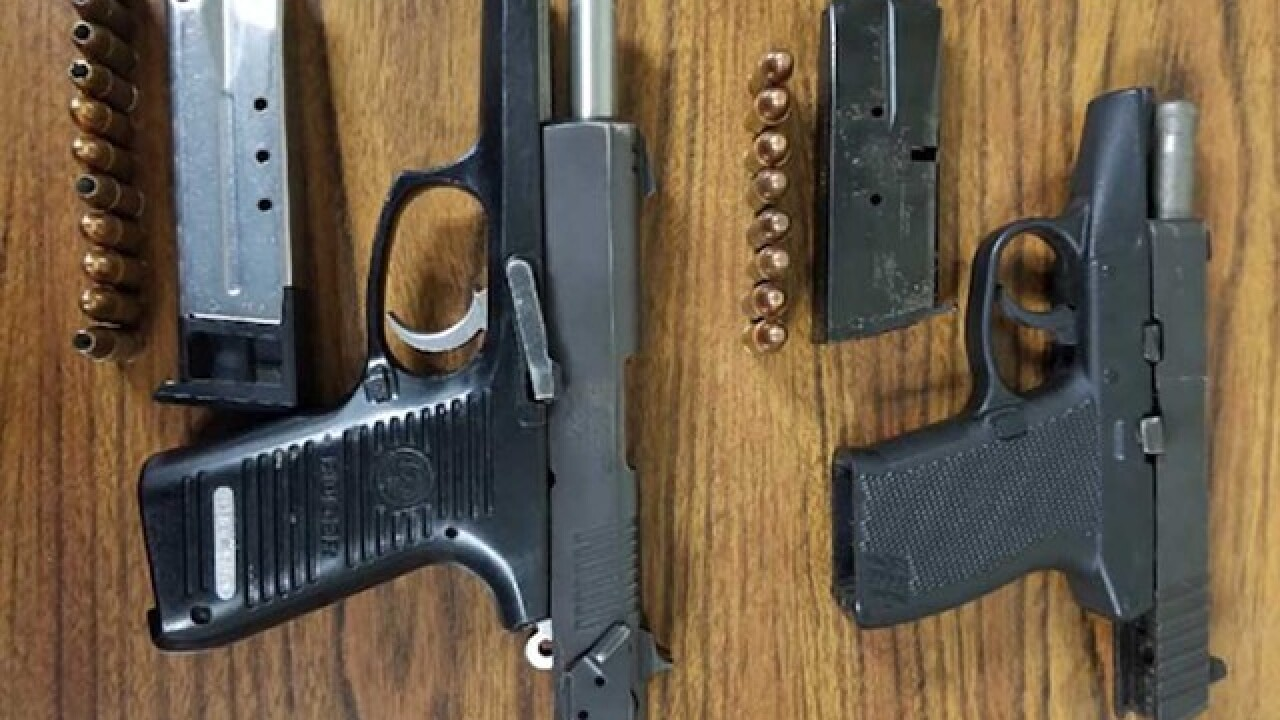 Two loaded guns seized in Baltimore arrest