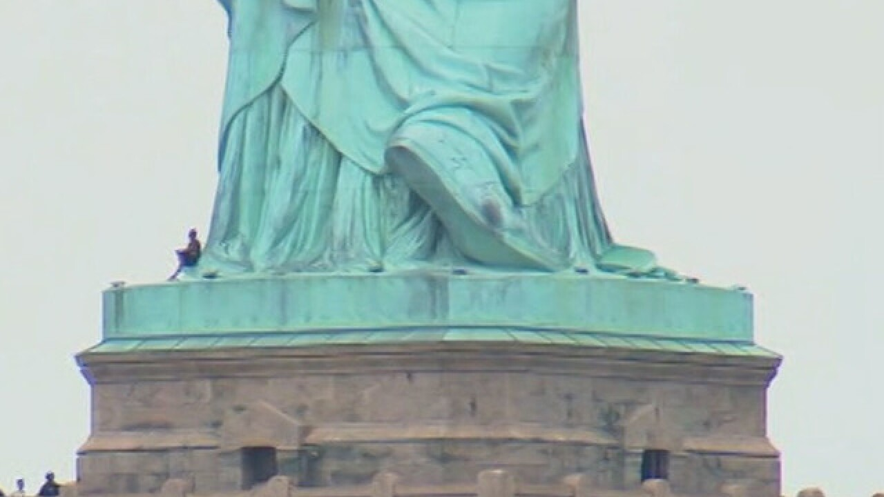 Person reportedly climbed up Statue of Liberty