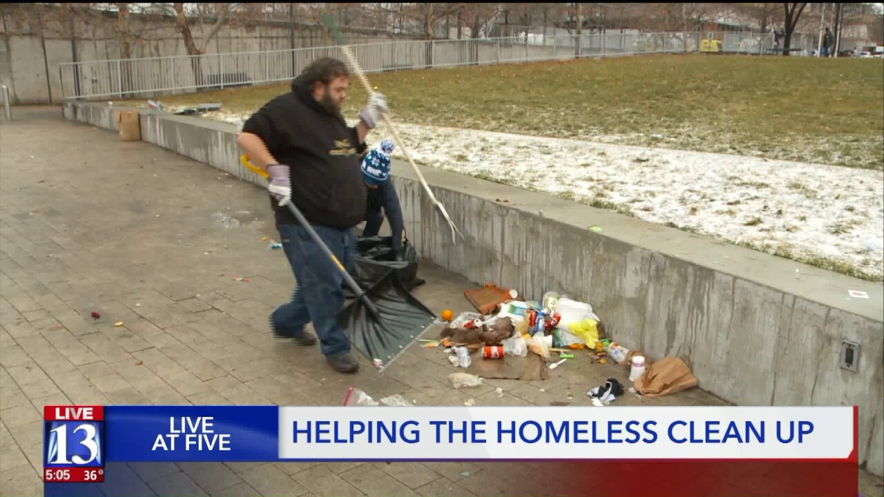 After Christmas gifts and meals for the homeless, volunteers help clean up Library Square