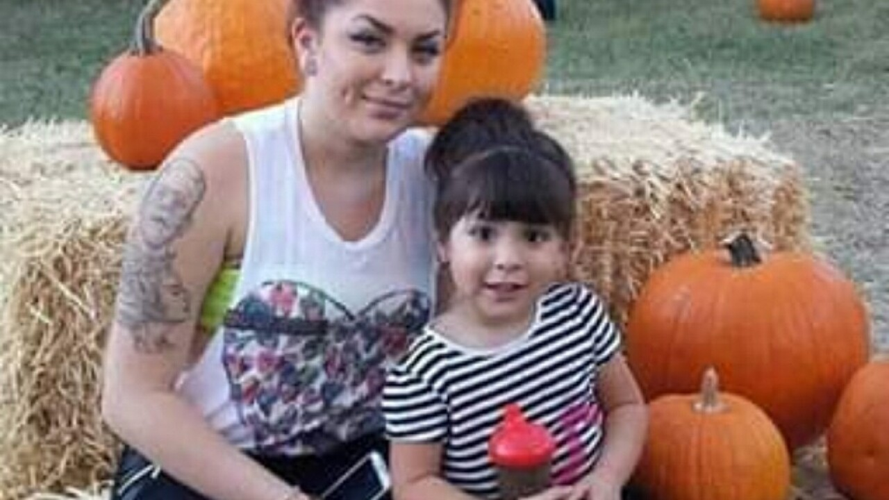 2019-07-01 I-19 Killing- Marilyn and daughter-pumpkins.jpg
