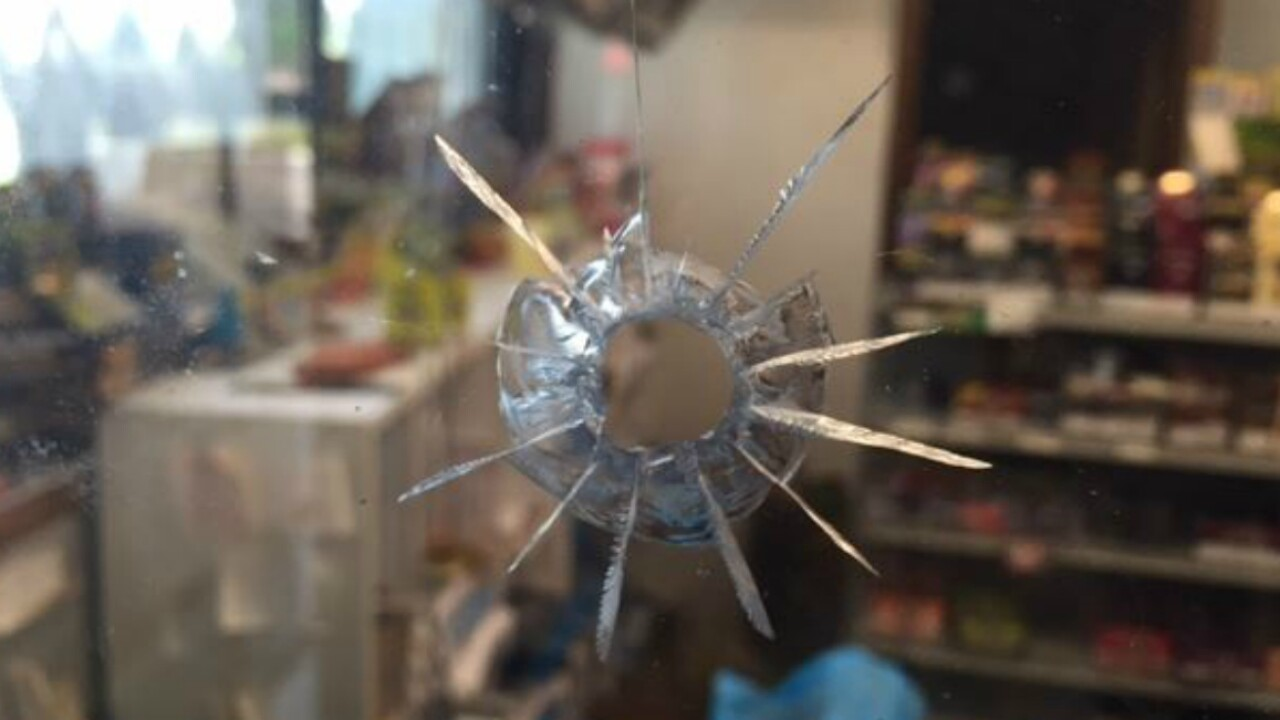 'I saw these young boys run in,' says witness who saw masked gunmen shoot gas stationclerk