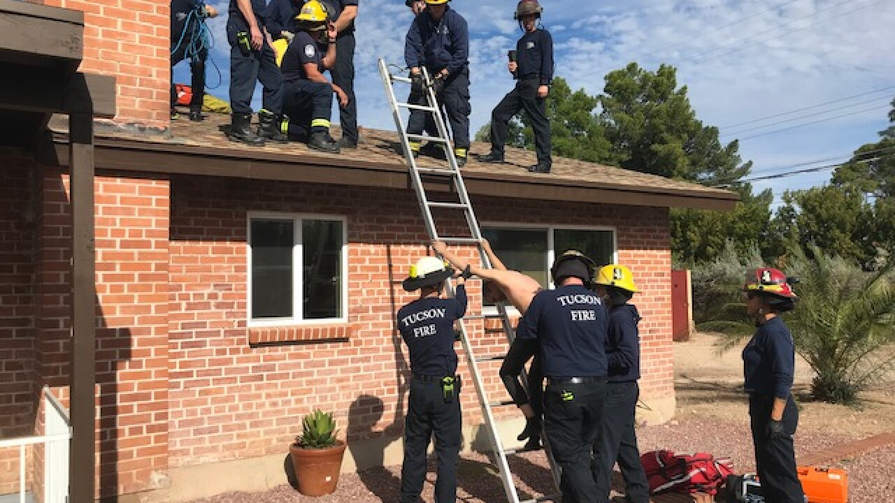 Tucson Fire crews responded to a midtown home Friday to rescue a man stuck in a chimney.