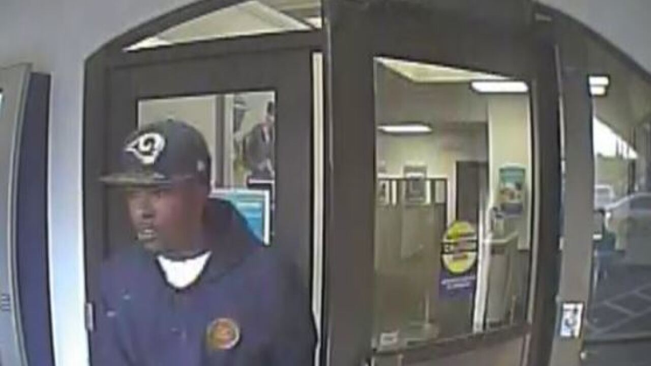 Police search for 2 armed bank robbery suspects