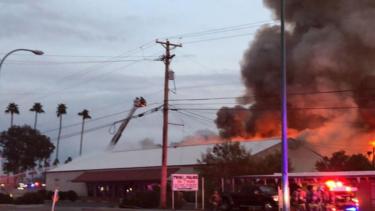 Crews battle massive structure fire near Main Street and Gilbert Road in Mesa