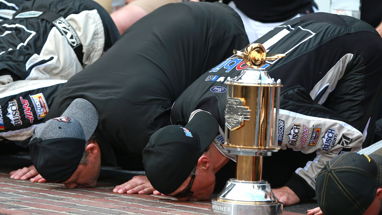 Jimmie Johnson's playoff run ends as Kevin Harvick captures second Brickyard