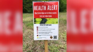 Health alert signed posted at Spillway Park in Lake Worth Beach on May 14, 2021.