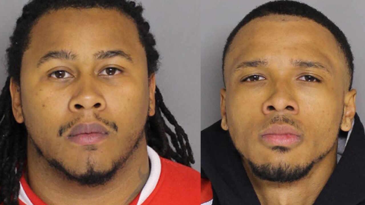 Two men charged in Towson double homicide