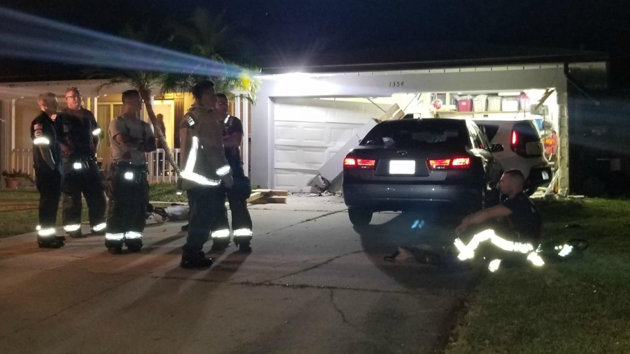teen crashes stolen SUV into house