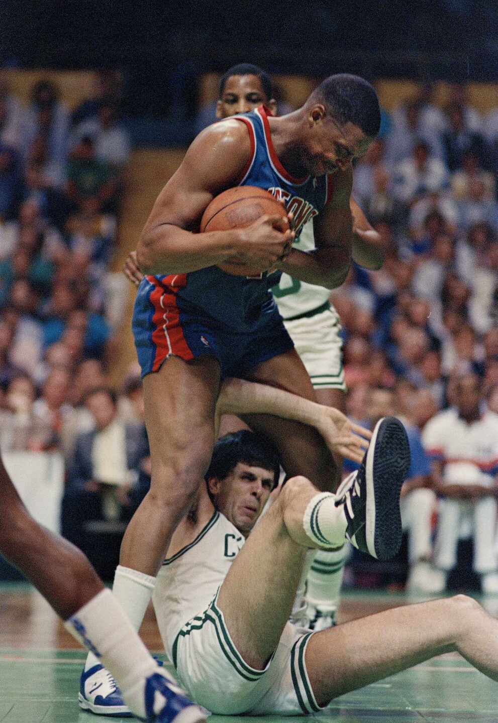 Rick Mahorn stands over Kevin McHale