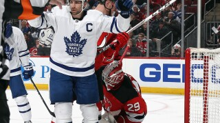 NEWARK, NEW JERSEY - DECEMBER 27: John Tavares #91 of the Toronto Maple Leafs celebrates the game tying goal at 8:15 of the third period on the powerplay against the New Jersey Devils at the Prudential Center on December 27, 2019 in Newark, New Jersey. The Maple Leafs defeated the Devils 5-4 in overtime. (Photo by Bruce Bennett/Getty Images)