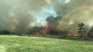 Fire Crews battle large brush fire in Hendry County