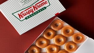 Get a dozen free doughnuts from Krispy Kreme this week