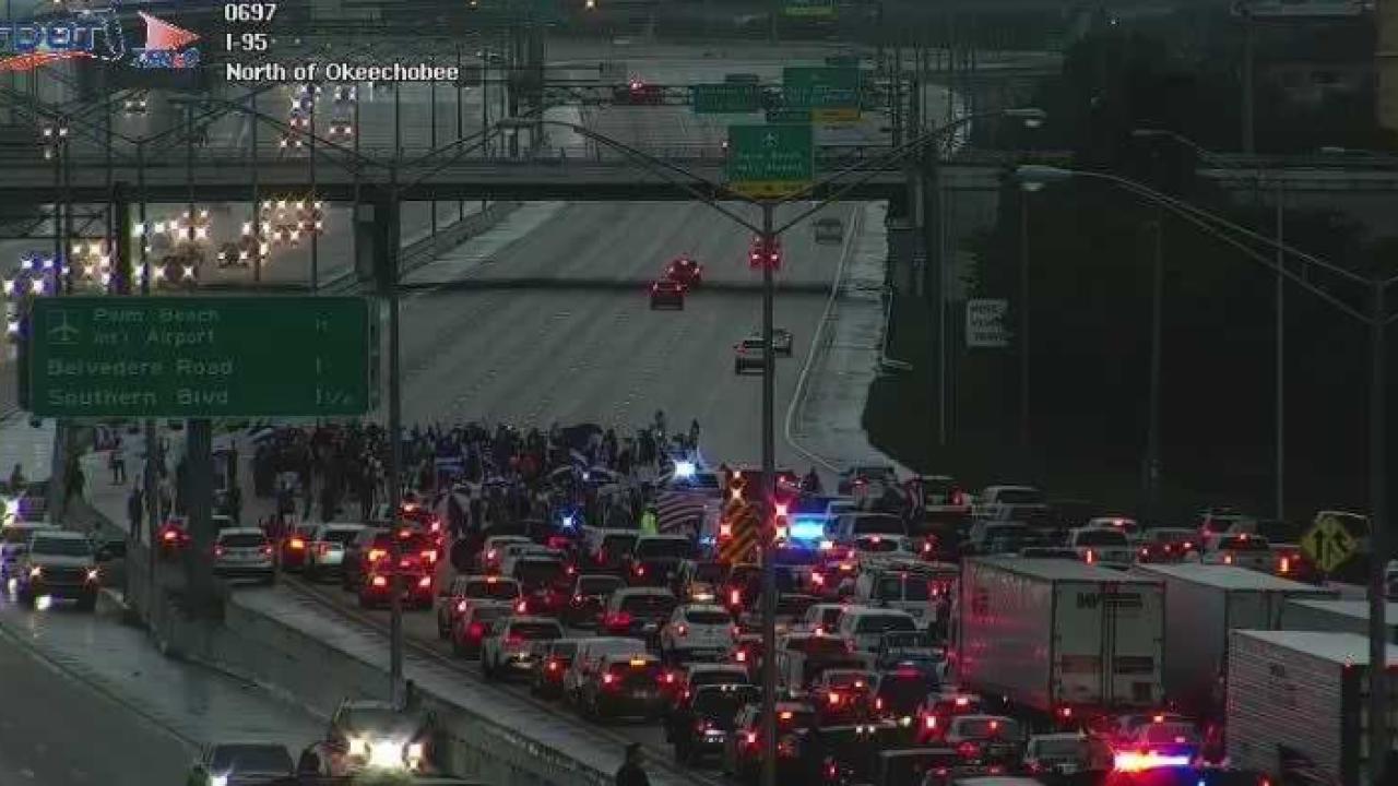 Cuba protesters shut down I-95 near the Okeechobee Boulevard exit on July 13, 2021