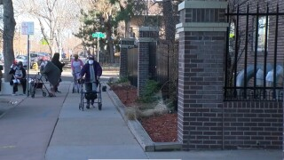 Residents protest outside of the California Park East Apartments in Denver