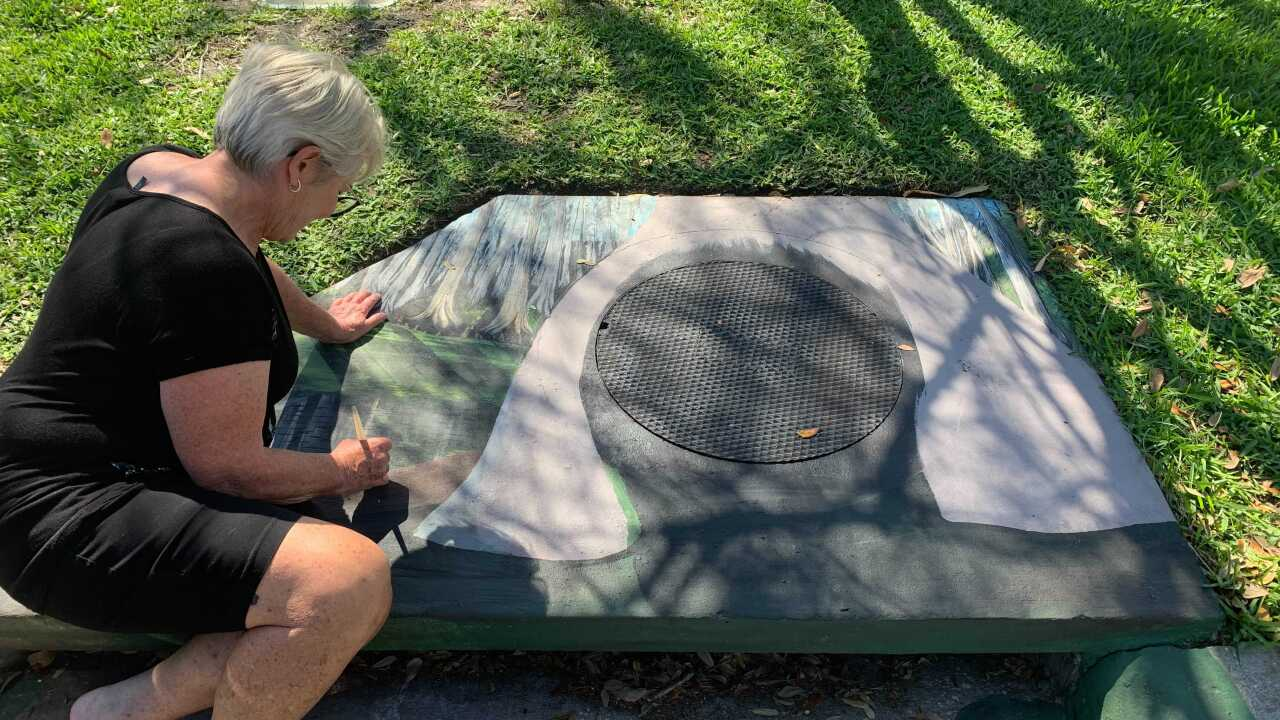 painting on storm drains