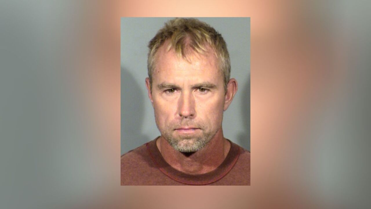 Las Vegas police arrest ex-USA Gymnastics coach for lewdness with a minor