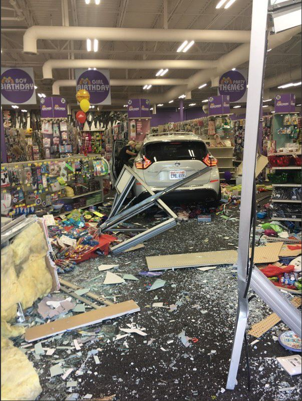 Photos: Car crashes through front of party supply store in Orem
