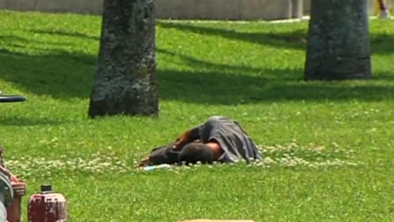 Homeless man sleeping in West Palm Beach.