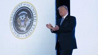 Trump appeared on stage with doctored presidential seal featuring golf clubs and Russian imagery