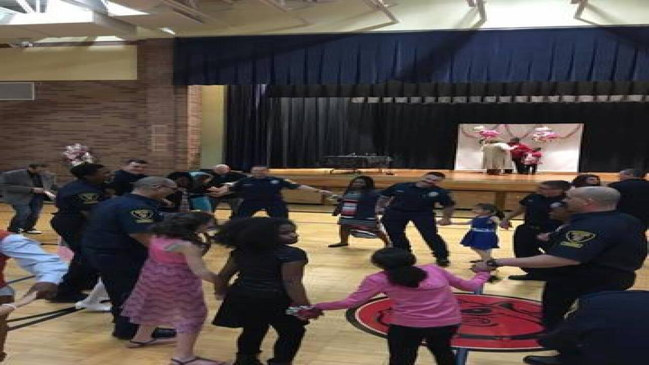 PHOTOS: Firefighters take students to dance