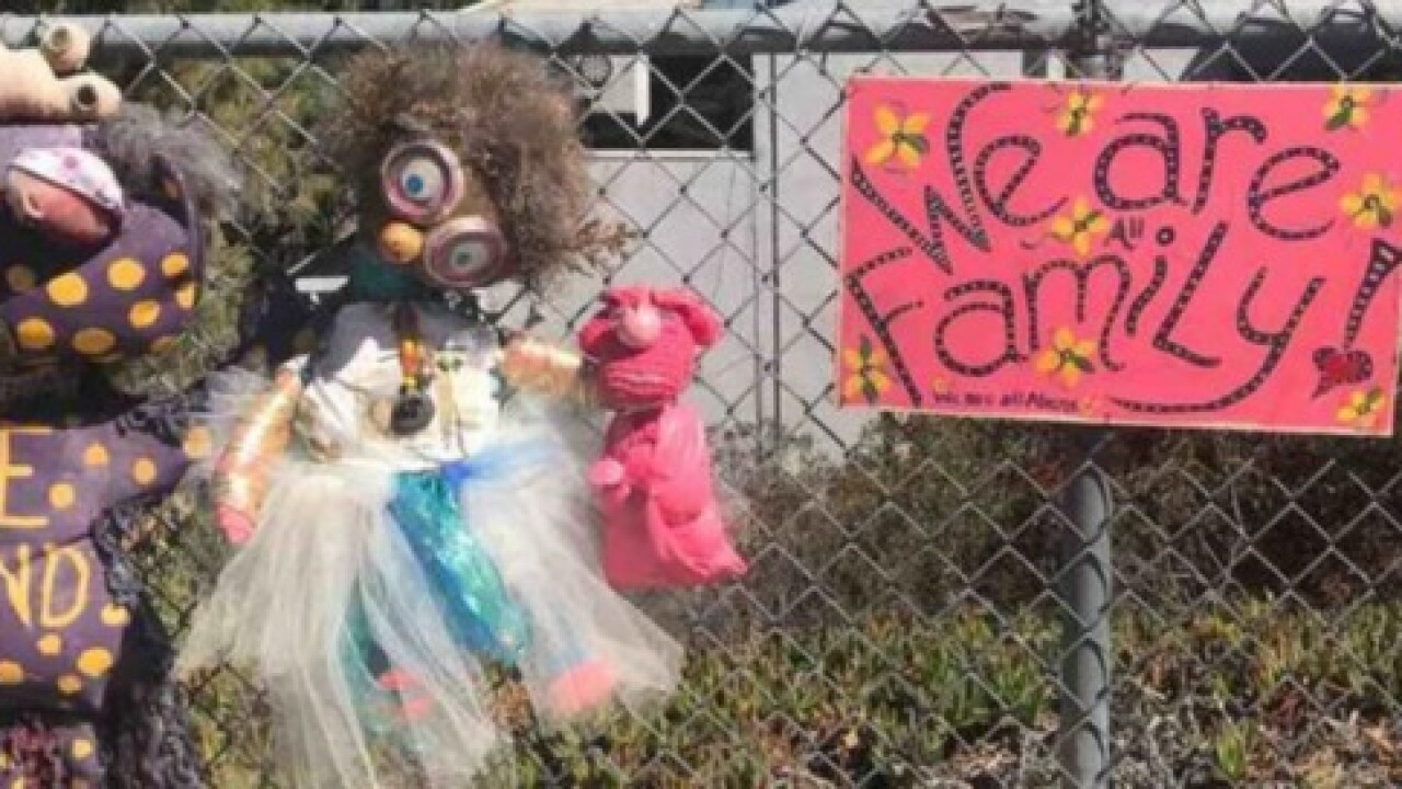Ailing artist's work stolen from beloved fence