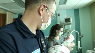 Ken and Erin Meich with newborn twins.jpg