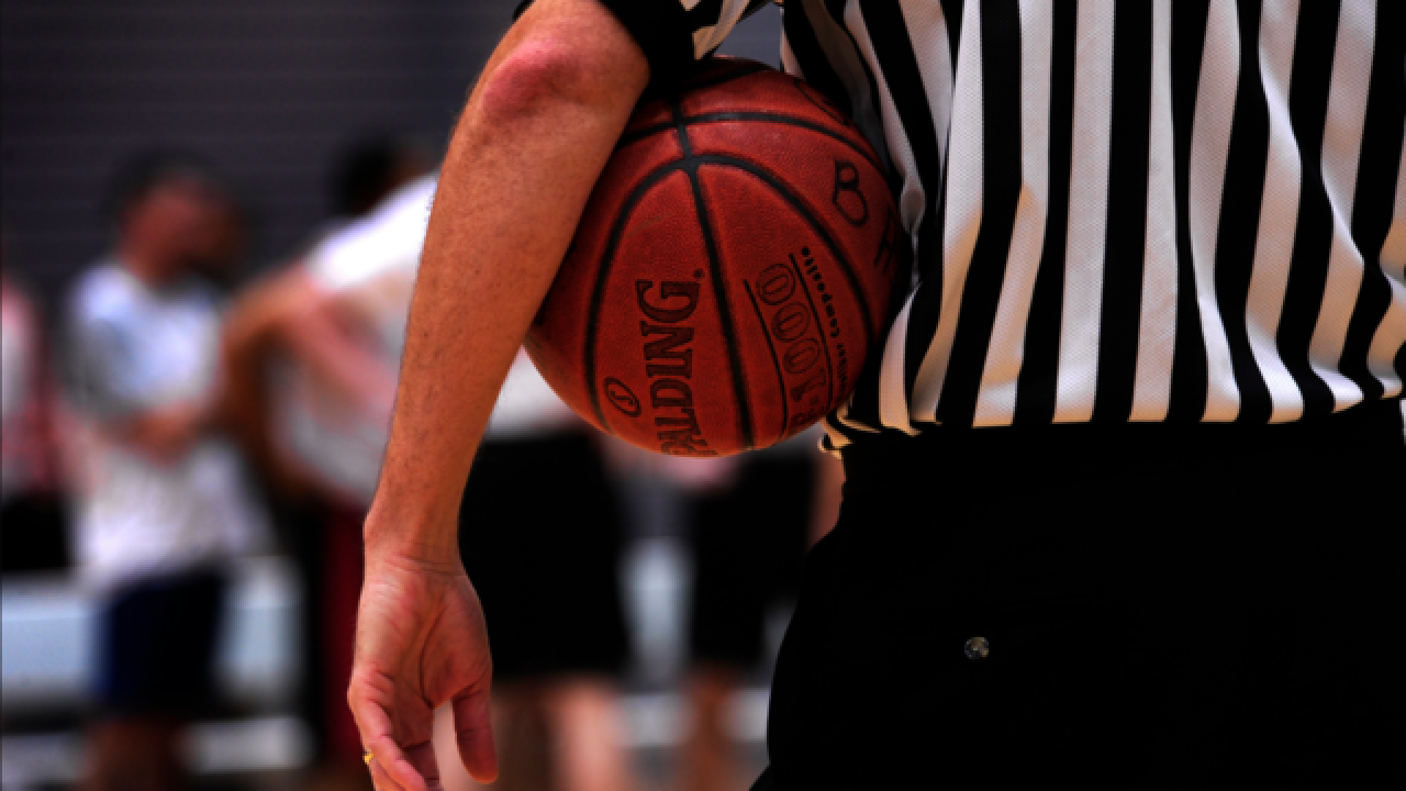 Wisconsin basketball coach accused of attacking a referee resigns