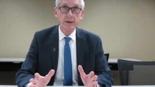 Wisconsin Governor Tony Evers wearing a blue suit and blue tie
