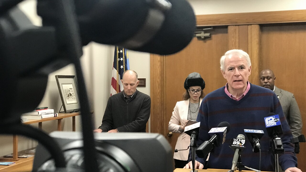 Milwaukee Mayor Tom Barrett, wearing a blue and red sweater, discusses cold-weather preparation Tuesday