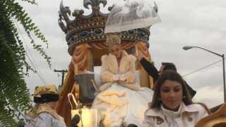 Parading through Lundi Gras: Queen Evangeline rolls in Lafayette