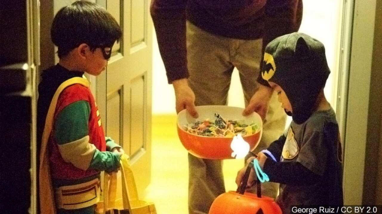 'Halloween Helpers' assist seniors during trick-or-treating
