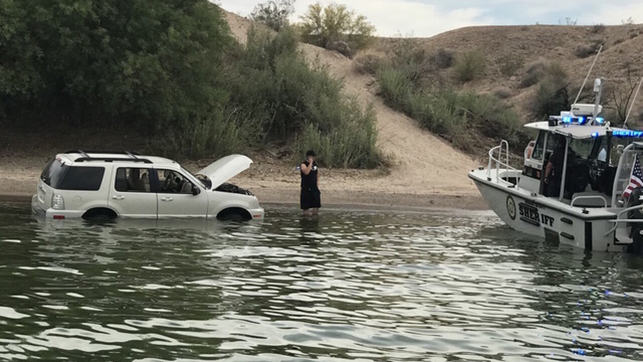 Men drive car into Lake Havasu while making bet; officials remove disabled car from water