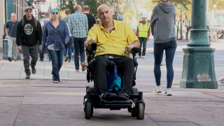 Denver man says a scooter, on the sidewalk, slammed into his wheelchair.png