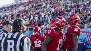FAU Owls football players celebrate TD while wearing C-USA patches on their jerseys, Sept. 11, 2021