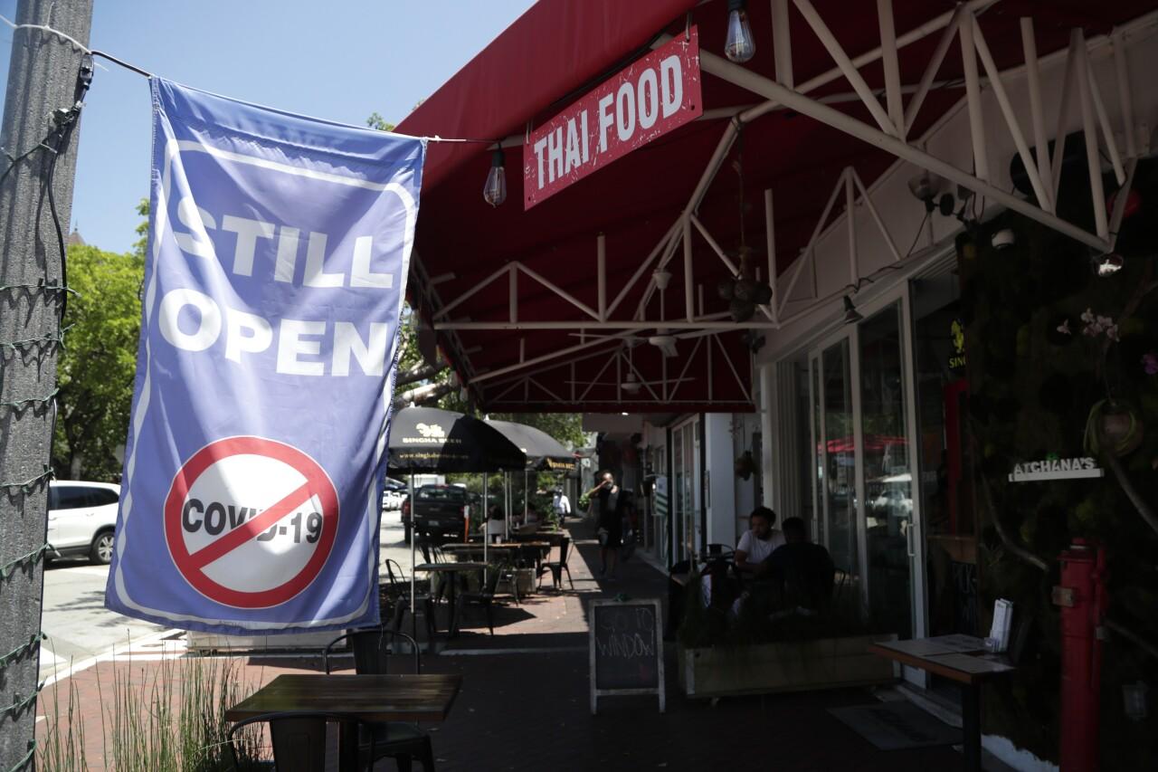 'Still Open' sign outside restaurant in Coconut Grove, Aug. 6, 2020