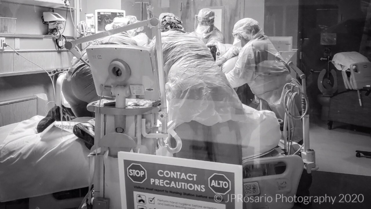 JFK Medical Center ICU nurse JP Rosario captures the moment a team rushes to help a patient on a ventilator.