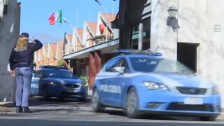 Italian police cars leaving the rapid reaction unit base in Rome.