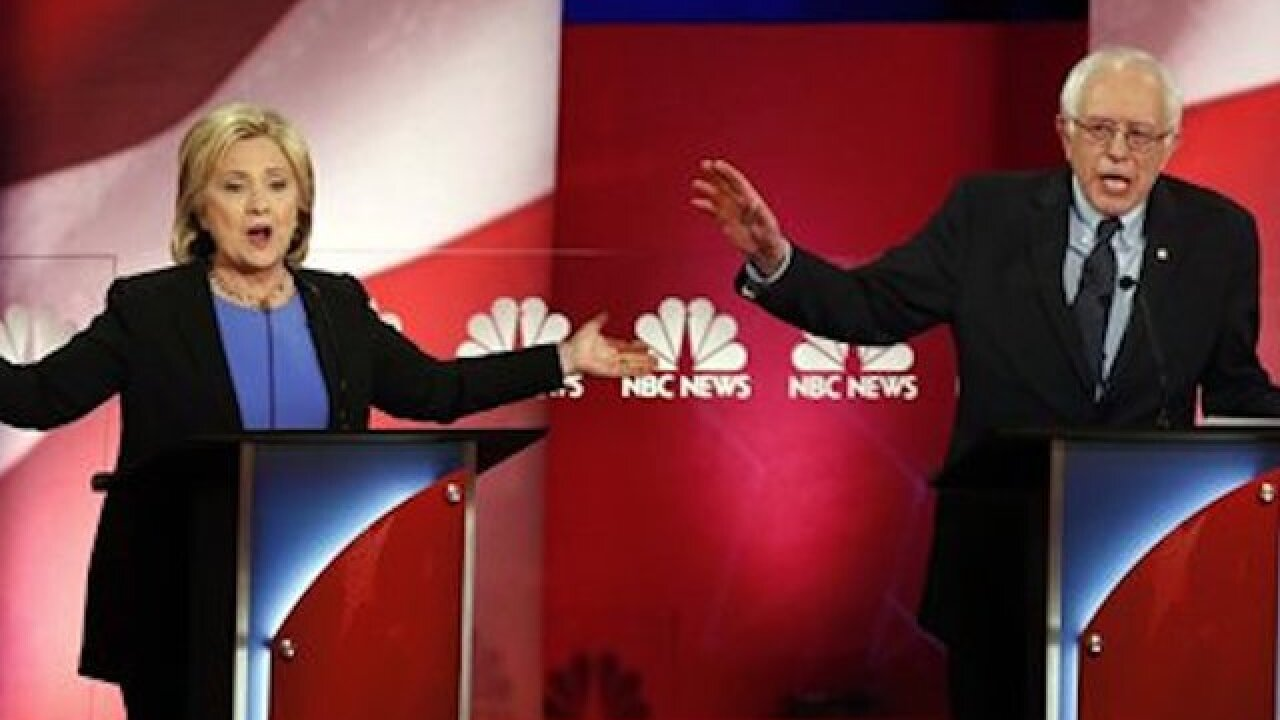 Clinton, Sanders clash over economic divide