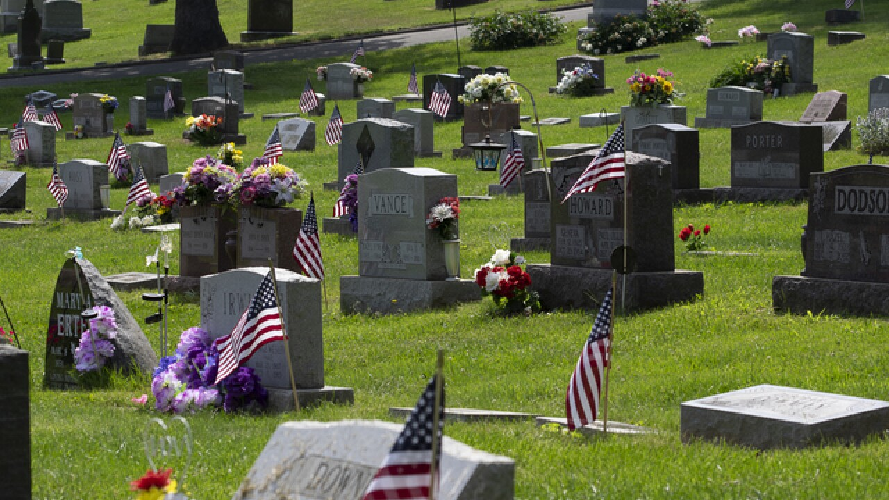 Scouts place flags at West Chester Township Cemetery for Memorial Day