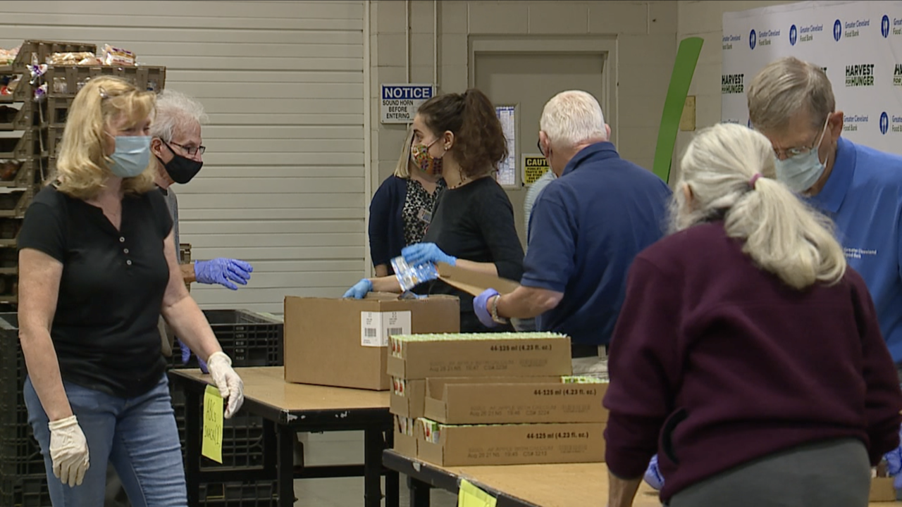 volunteers packing boxes at food bank.png